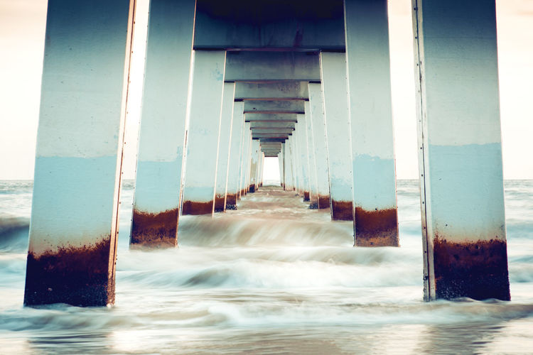 Underneath view of pier at beach