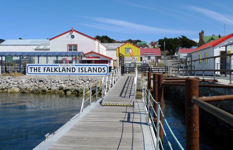 Showcase July Falkland Falklandislands Port Port Stanley Summer Landing Bridge Colourful Houses Aestethic Idyllic Scenery Architecture No People Blue Sky Pier Yellow Buildings Cruise Diminishing Perspective Tourism Holiday Outdoors Freshness