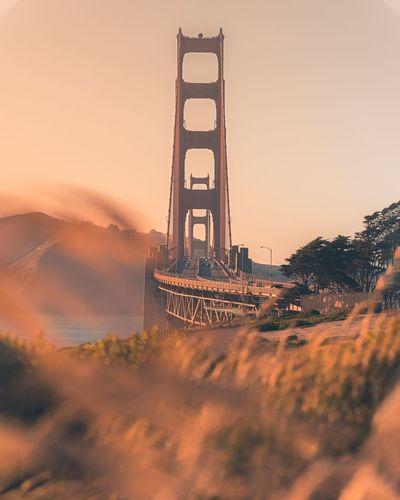 Golden gate bridge against clear sky during sunset