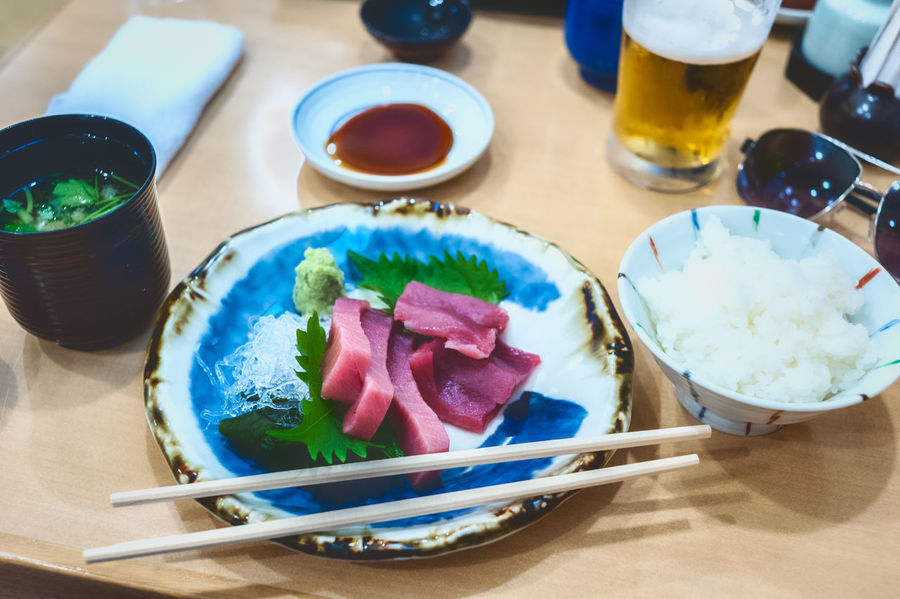 Maguro sashimi in Japan. Beer Japan Sushi Bowl Close-up Drink Fish Food Food And Drink Freshness Healthy Eating High Angle View Indoors  Japanese Food Maguro Meal No People Plate Ready-to-eat Sashimi  Serving Size Still Life Table Temptation Vegetable