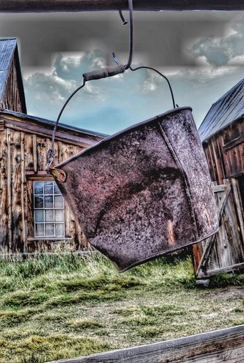 Rusty bucket Built Structure Architecture Sky Building Exterior Cloud - Sky Nature Building No People House Day Auto Post Production Filter Plant Outdoors Abandoned Field Run-down Grass Obsolete Damaged Old