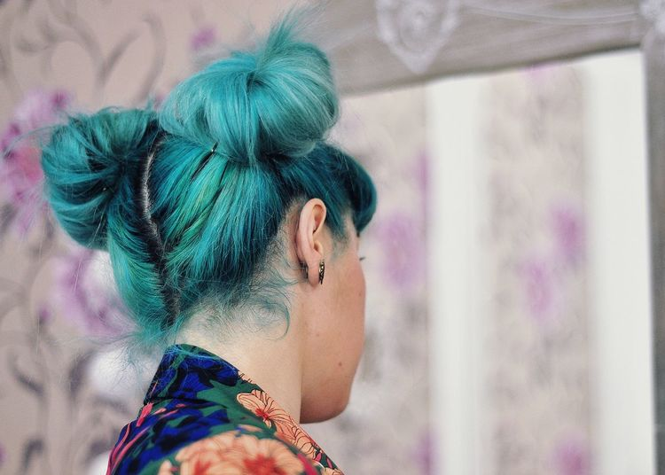 Young Woman With Dyed Hair By Mirror At Home