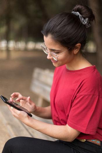 Girl sitting on mobile phone