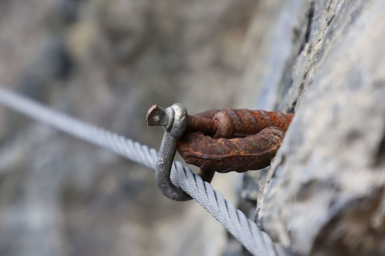 Close-up of rope in hook attached to wall