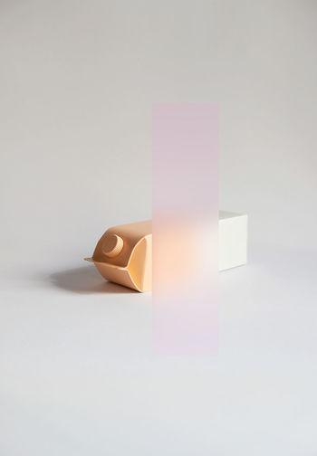 Close-up of illuminated lamp against white background