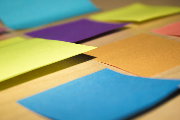 Close-Up Of Blank Colorful Sticky Notes On Table