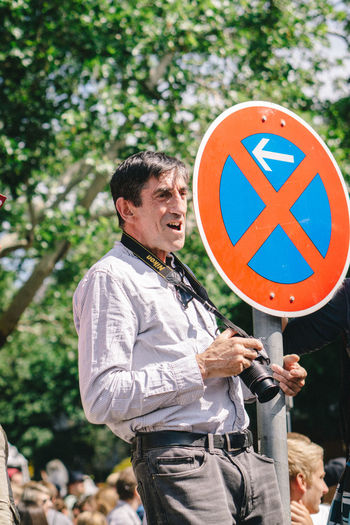Man standing on road sign