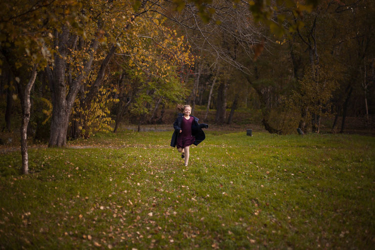 Full Length Nature Beauty In Nature One Person Tree Grass Outdoors People Night Adult Autumn Colors Autumn осень фея Nature Tree Real People Day Front View Children Only One Girl Only Run
