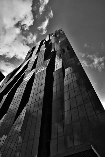 DC Tower in Vienna Architecture Cloudy DC Tower Leading Lines Vienna Architecture Black And White Building Building Exterior Built Structure City Cloud - Sky Day Design Low Angle View Modern Moody No People Office Building Exterior Outdoors Reflection Sky Skyscraper Tall - High Travel Destinations The Architect - 2018 EyeEm Awards