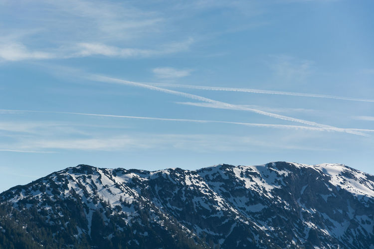 Sky Mountain Beauty In Nature Scenics - Nature Snow Vapor Trail Cloud - Sky Winter Cold Temperature Mountain Range Tranquil Scene Tranquility Nature No People Day Snowcapped Mountain Non-urban Scene Blue Environment Mountain Peak Formation Tree Travel Destinations Panorama The Great Outdoors - 2019 EyeEm Awards