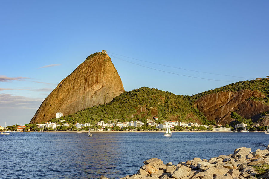 View of Botafogo cove with its waters and boats, Sugar Loaf hill and Urca district Brazil City Rio De Janeiro Sugar Loaf Mountain Clear Sky Day Guanabara Bay Hill Landscape Mountain Nature No People Outdoors Rock - Object Scenics Sea Sky Sugarloaf Summer Tranquility Transportation Travel Destinations Urban Water Waterfront