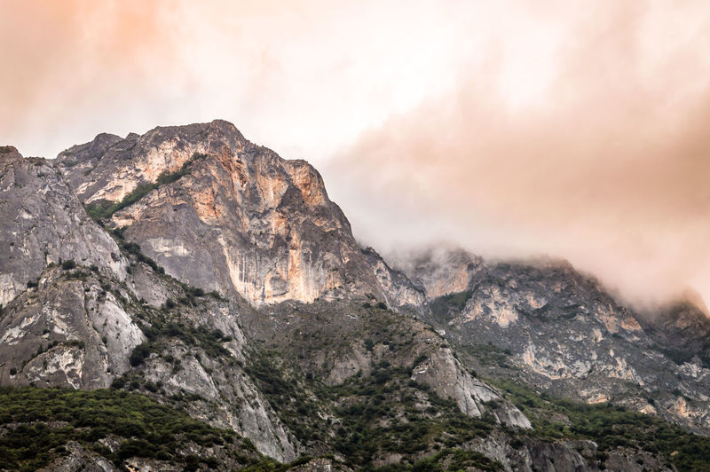 Copper Sky in the Pyrenees, Andorra Mountain Scenics - Nature Rock Sky Nature Environment Rock - Object Mountain Range Cloud - Sky Land Landscape Solid Beauty In Nature No People Mountain Peak Cliff Outdoors Tranquil Scene Tranquility Formation