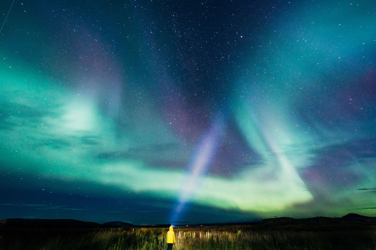 Young woman looking at aurora