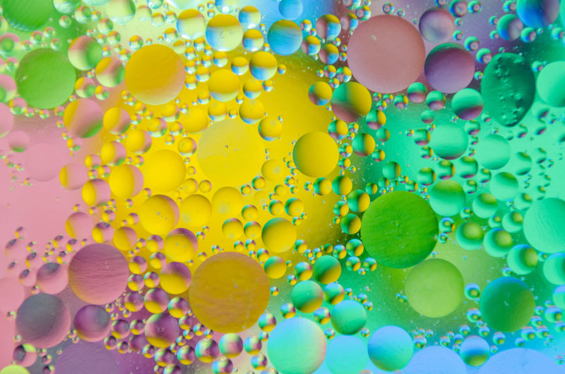 Close-Up Of Colorful Bubbles In Water