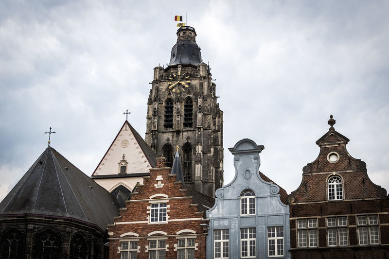 Oundenaarde, Belgium Belgium Architecture Belief Building Building Exterior Built Structure Cloud - Sky Day History Low Angle View No People Oudenaarde Outdoors Place Of Worship Religion Sky Spire  Spirituality The Past Tower Travel Destinations