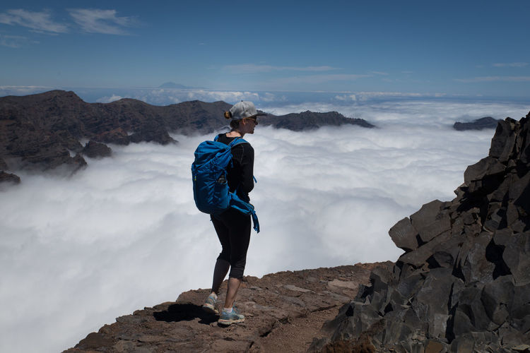 Woman Activity Beauty In Nature Cloud - Sky Hiking Leisure Activity Lifestyles Nature One Person Outdoors Real People Rock Rock - Object Roque De Los Muchachos Scenics - Nature Sky Volcano