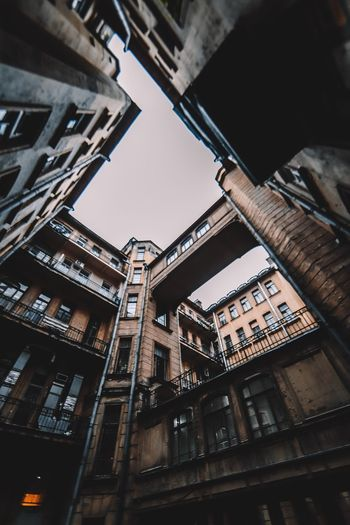 Built Structure Architecture Low Angle View Building Exterior No People Sky Text Outdoors Nature Clear Sky Residential District City Tall - High Western Script Building Day Communication Sunlight Window