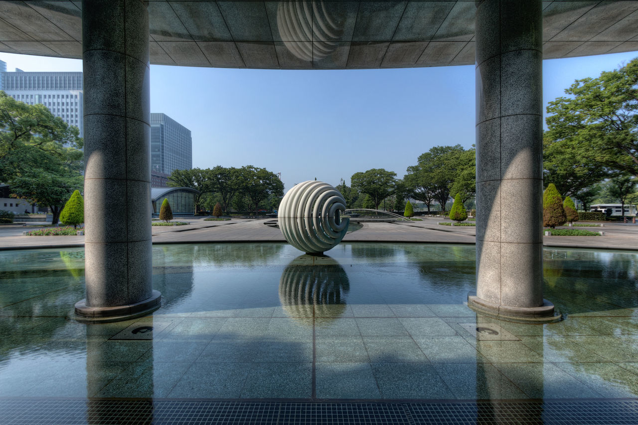 water, reflection, swimming pool, day, tree, no people, outdoors, architecture, built structure, nature, bridge - man made structure, clear sky, sky