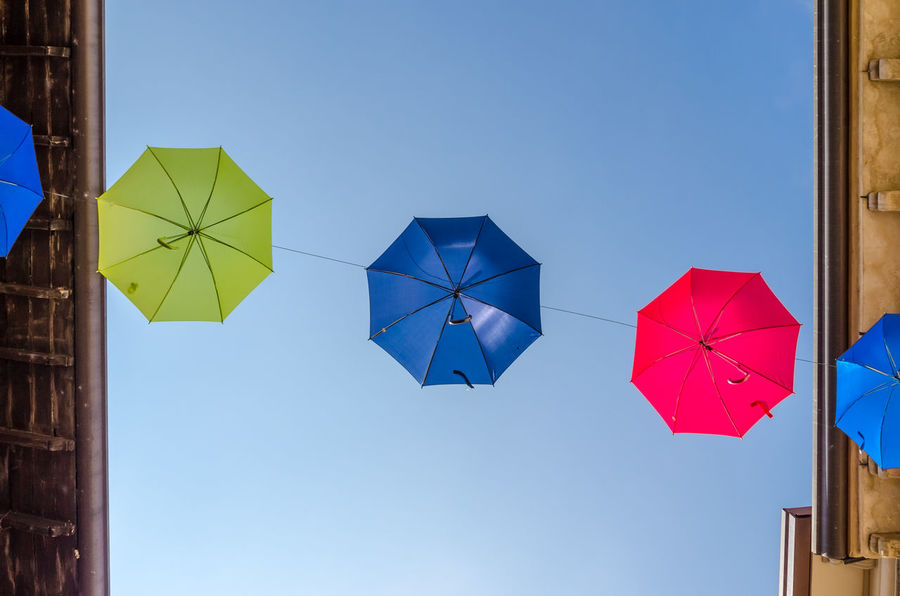 Umbrellas over Rivoltella. Italy. Clear Sky Hanging Low Angle View Aligned Array Blue Day Decoration Europe Garda Group Italy Lake Lookingup Multi Colored No People Outdoors Sky Umbrella Warm
