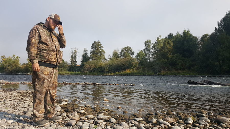 By a River in Oregon Camouflage Camouflage Clothing Camo Camping Oregon River Riverbank Riverscape Water Waterfront EyeEm Selects Men Standing Farmer Full Length Sky Fisherman Fishing Fishing Industry Hiker Shore