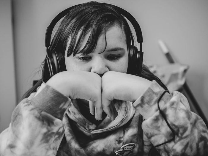 Close-up of girl listening music at home