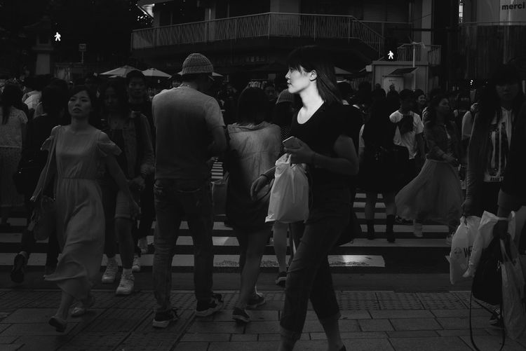 People walking on street in city at night