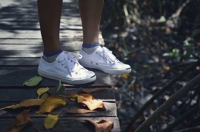 Shoe Low Section Human Body Part Body Part Human Leg One Person Day Standing Outdoors Focus On Foreground Human Foot Close-up Real People Plant Part Canvas Shoe Leisure Activity Lifestyles