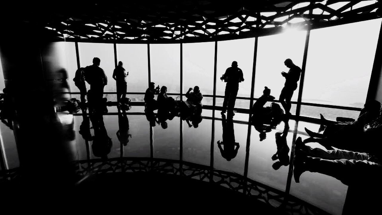 indoors, real people, medium group of people, silhouette, walking, men, lifestyles, leisure activity, women, standing, day, full length, architecture, people