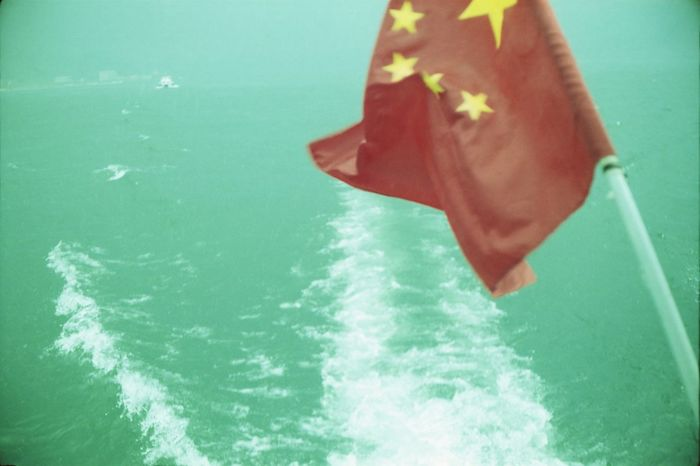 Analogue Photography Boat Chinese Flag Complementary Colors Contrast Day Green Lake Leisure Activity Low Section Motion Nature Nautical Vessel North Korea Red Sea Water Waterfront