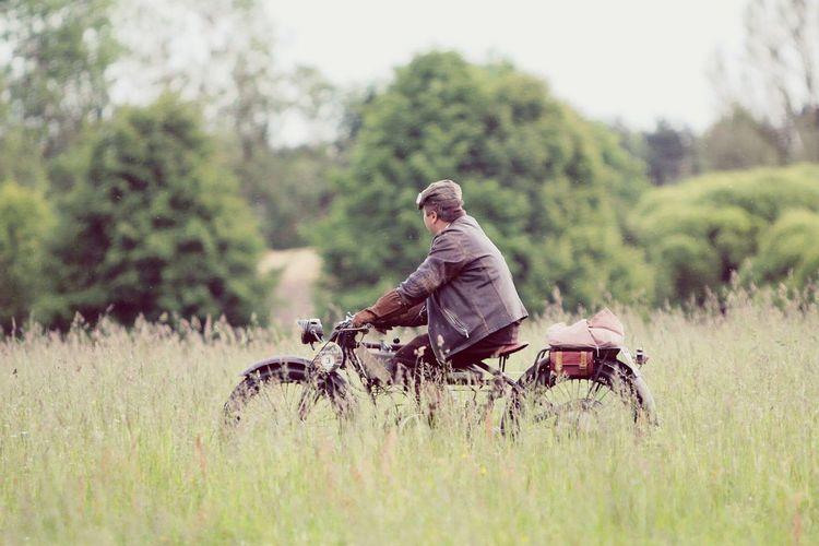 Man On Old Motorbike