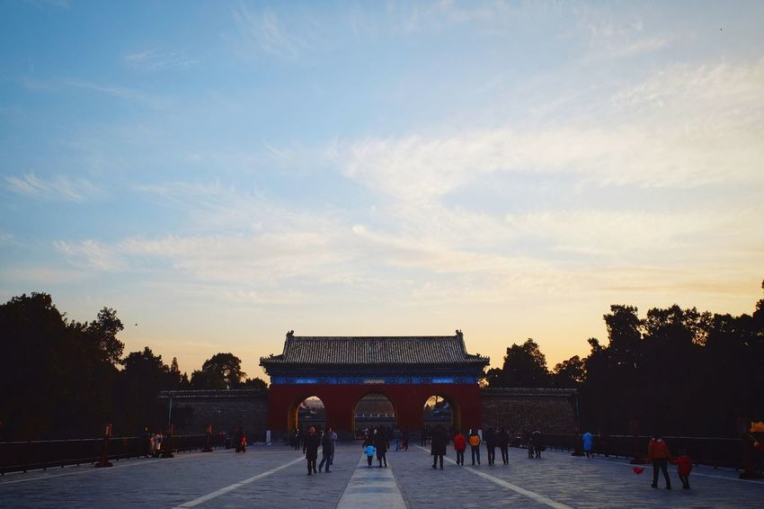 Large Group Of People History Travel Destinations Architecture Tourism Ancient Gate Built Structure Silhouette Travel People Cloud - Sky Outdoors Leisure Activity Sunset Building Exterior Royalty Warm Light Temple Of Heaven Park Beijing, China FUJIFILM X-T10 Light And Shadow Palace Travel Warm Colors