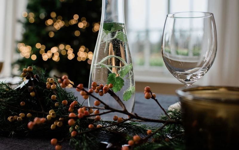 Close-up of christmas decoration on glass table