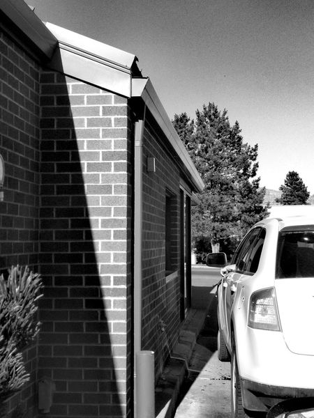 Built Structure Outdoors Transportation Day Building Exterior Architecture Tree Sky Liv'n The Dream Traveler Fast Food Drive Through Blackandwhite Black And White Monochrome Monochrome Photography Human Body Part Arm Human Arm Vehicle Tail Light Windows Car Brick Wall Brick Building EyeEm Selects Black And White Friday