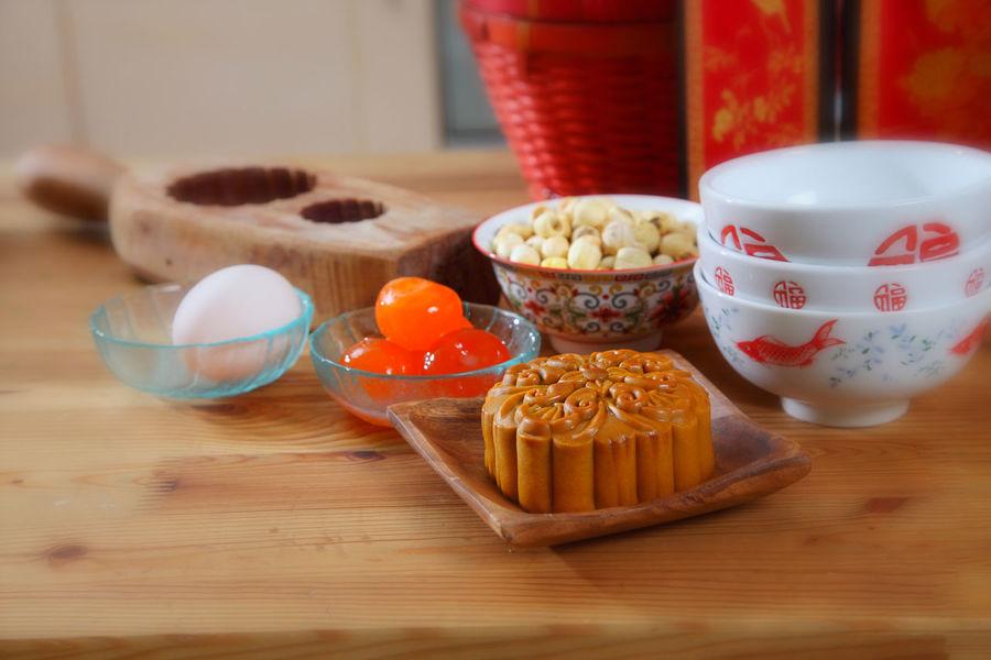 moon cake for the mid autumn festival Asian  Celebration Dessert Egg Yolk Salted Egg Yolk Bakery Baking Chinese Cultures Egg Gourment Hand Mold Handmade Ingredient Lotus Paste Mid Autumn Festival Moon Cake Mooncake Mould Oriental Traditional