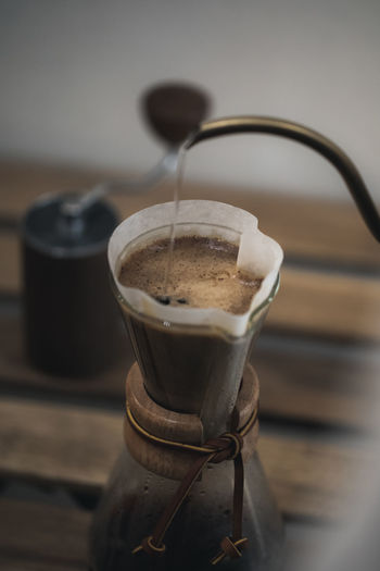 Coffee Brewing and Coffee Making Ijas Muhammed Photography Drink Food And Drink Refreshment Coffee Coffee - Drink Still Life Table Indoors  Close-up Focus On Foreground No People Freshness Household Equipment Wood - Material Coffee Maker Selective Focus Frothy Drink Coffee Cup Appliance Glass