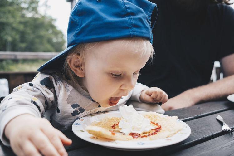 Cute boy eating food