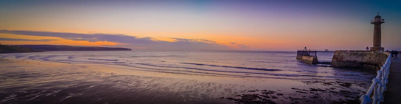 sunset, sea, beach, water, wave, cloud - sky, horizon over water, travel destinations, sand, nature, sky, outdoors, scenics, tranquility, no people, beauty in nature, tranquil scene, vacations, lighthouse, day