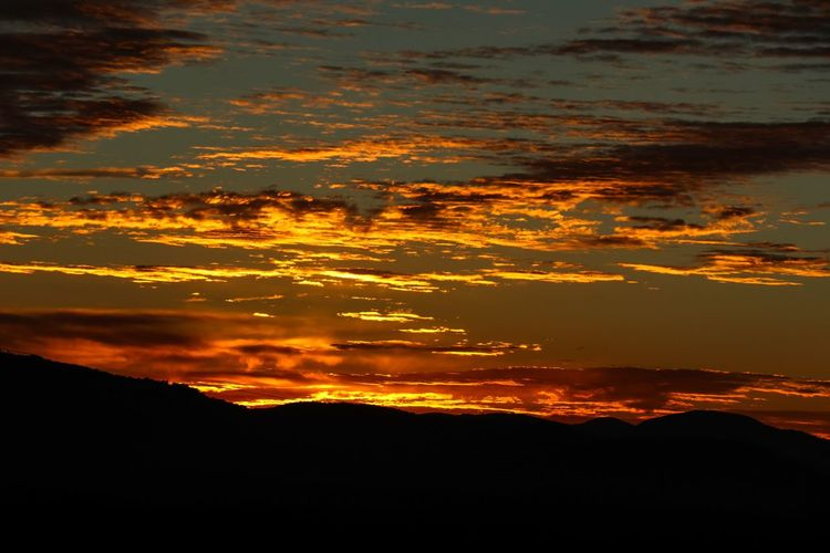 Fiery sunrise in the Blue Ridge Mountains Clouds And Sky Colors Sunrise Beauty In Nature Water Orange Color Scenics - Nature Sky Nature Silhouette No People Tranquility Tranquil Scene Idyllic Outdoors Cloud - Sky Mountain Non-urban Scene Sunlight Land