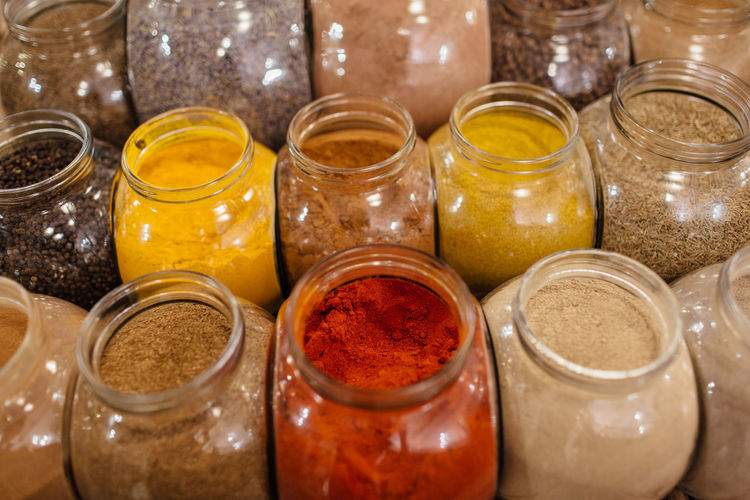 Colorful spices in glass jars. Composition of colorful assorted spices and herbs in glass jars in packaging free shop. Zero Waste Plastic Free Package Shop Store Raw Food Food Refill Organic Shopping Business Homemade Horizontal Grocery Freshness Bulk Interior No People Glass Jar Spice Colorful Bio Eco