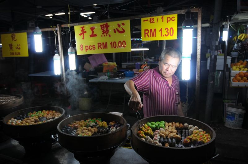 Man standing with vegetables