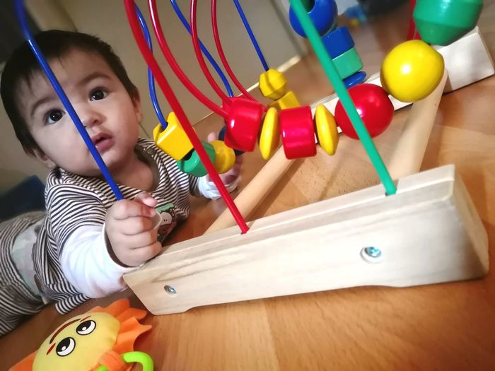 Cute Baby Boy Playing With Toys At Home