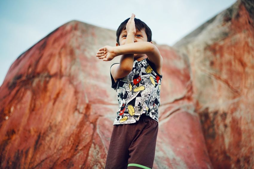 fighting pose Kidsphotography Kids Being Kids Kids EyeEmNewHere Playing Childhood Child Standing Flexibility Skill  Sky Rock Climbing Rock Face Free Climbing The Portraitist - 2018 EyeEm Awards