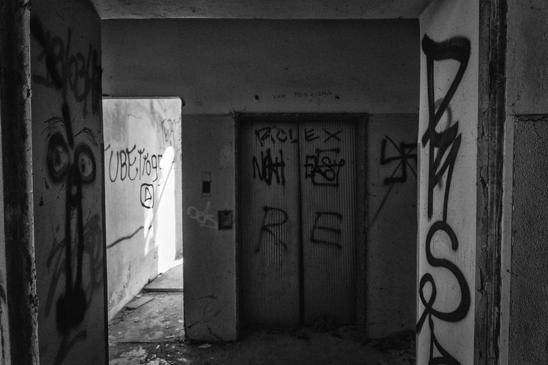 Text Graffiti Architecture Wall - Building Feature Communication Built Structure Art And Craft Western Script No People Creativity Street Art Building Exterior Door Day Entrance Sign Wall Abandoned Architectural Column Message Mental Hospital