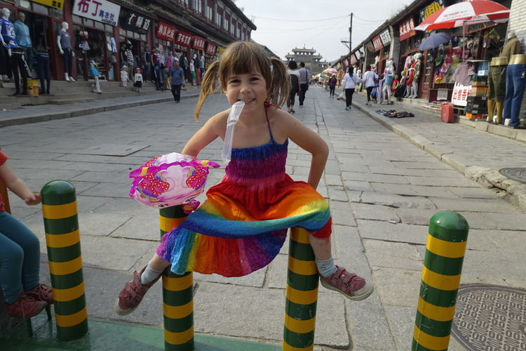 Enjoying China Architecture Building Exterior Childhood China City Day Full Length Fun Girls Happiness Incidental People Leisure Activity Lifestyles Looking At Camera Multi Colored One Person Outdoors People Playing Portrait Real People Skill  Smiling Travel With Kids Xingcheng