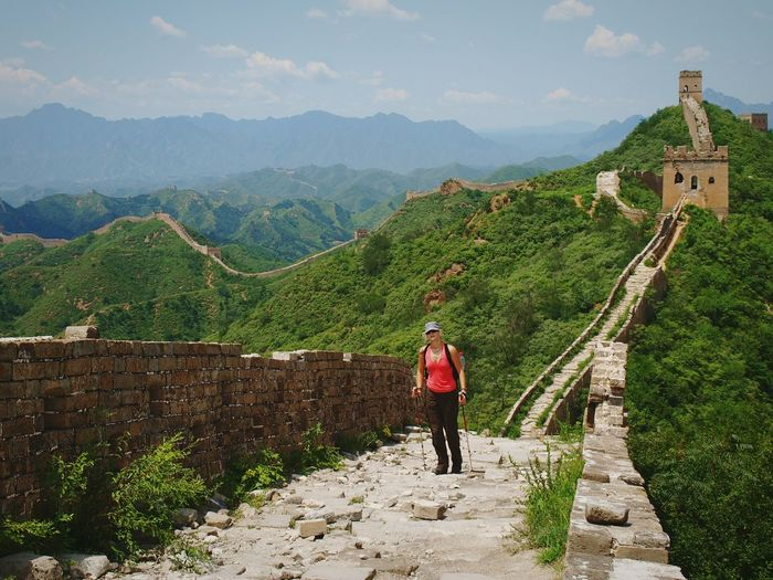 Woman With Hiking Poles Standing At Great Wall Of China