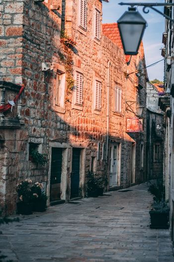 Golden hour Street Architecture Old City Building Day Town No People Building Exterior Built Structure Residential District Direction The Way Forward Footpath Lighting Equipment House Outdoors Nature Narrow Window Alley
