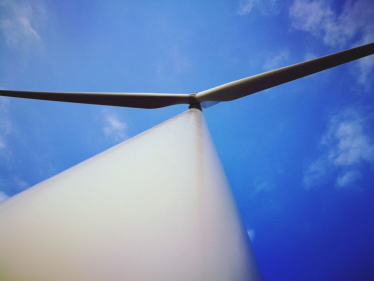 Wind Power Alternative Energy Fuel And Power Generation Wind Turbine Windmill No People Sky Renewable Energy Outdoors Day Technology Tranquility Wind Farm WindGenerator Close-up Vapor Trail Clear Sky Low Angle View Cloud - Sky