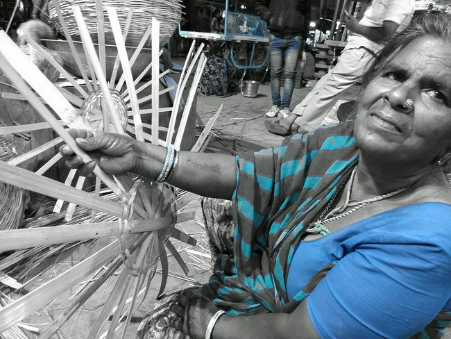Bawri devi, a sweet woman showing her tattooed name on her arm. Yesterday i purchased a wooden (bamboo) basket for vegetables, which was for hindu temples. But I don't mind as I needed a wooden basket for my vegetables . However, today while roaming in the market again sat down with her to talk a bit. Toady she wasn't able to sell a single basket despite all off her family involved in the same work. Purchasing Assamese bamboos @ RS. 180 for 16 feet and then not able to sell even single unit is real tragedy. Interestingly when I asked her about caste she replied that they belongs to Neechi jati (lower Caste) said adjust my son in anything because he was not able to study (isse videya nahin chardi - education didn't choose him) even i had given my jewellery worth Rs. 40,000 to Baniyan for the fees of Rs.1400. But when Baniyan died his sons didn't returned neither mine nor others jewellery. EyEmNewHere Tribal Women Tribal One Person One Woman Only Headshot Outdoors Front View Only Women Looking At Camera People Close-up Real People Portrait EyeEmNewHere Business Stories An Eye For Travel