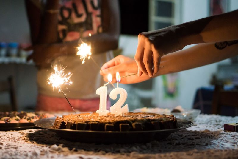 Do you remember your 12-year-old? Birthday Cake Birthday Candles Cake Sweet Food Food And Drink Celebration Food Birthday Flame Burning Human Hand Focus On Foreground