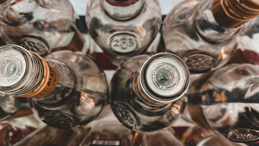 High angle view of bottles in jar